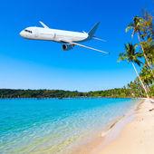 Jet plane over tropical sea — Stock Photo