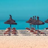 Beach scenery with parasol — Stock Photo