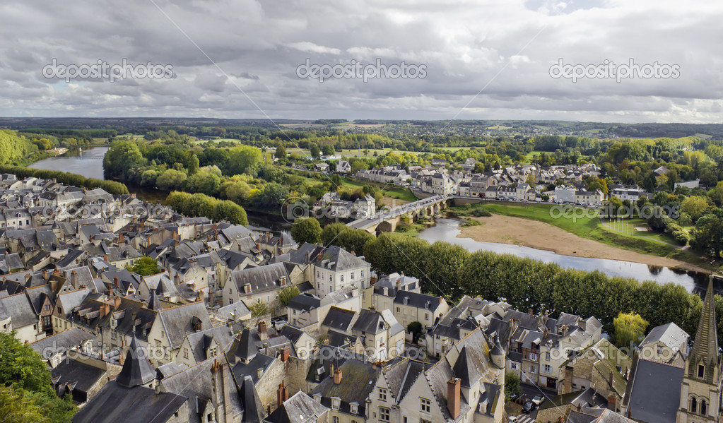 Panorama of the old French public domain standard town near the river and the forest. Tile roofs, stone bridge and narrow streets. Cloudy gray autumn day.  — 图库照片 #16766847