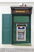 Green ATM cash dispense device — Stock Photo