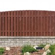 Stock Photo: Fence fragment from planks and bricks