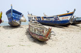 Old broken fishing boats on the African sea sand  — Stock Photo
