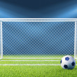 Football (soccer) goals and ball on clean empty green field - Stockfoto