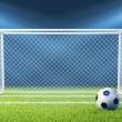 Football (soccer) goals and ball on clean empty green field - Stock Photo