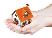 Hands holding offer house — Stock Photo