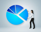 Financial report & statistics. Girl put sector of pie chart. — Stock Photo