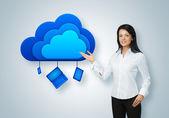 Cloud computing idea concept. Businesswoman points to the cloud — Photo