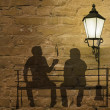 Two silhouettes on a bench — Stock Photo #31415985