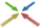 Meeting of four coloured characters arrow formations — Stock Photo