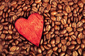Coffee beans and red heart — Stock Photo