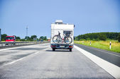 Camper on road — Stock Photo