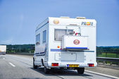 An image of camper on the highway — Stock Photo