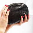 Hand and purse — Stock Photo