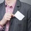 Businessman holding blank card — Stock Photo