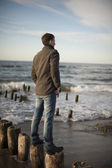 Man standing at breakwaters — Stock Photo