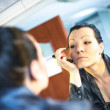 Woman doing make up — Stock Photo