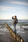 Man standing at breakwaters — Stock Photo
