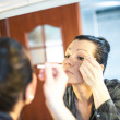 Woman doing make up — Stock Photo #25823351