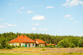 House among the meadows — Stock Photo