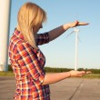 Woman and windturbine — Foto Stock