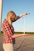 Woman and windturbine — Stock Photo