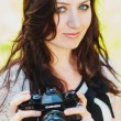 Stock Photo: Brunette girl and retro camera
