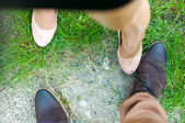 Top view of a female's and women's dress shoes — Stock Photo