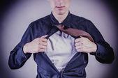 Young businessman pulls shirt — Stock Photo