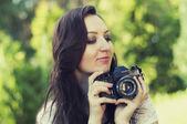 Beautiful woman photographer — Stock Photo