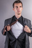 Young businessman pulls shirt — Stock Photo