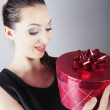 Girl holding red gift box — Stock Photo