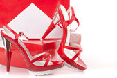 Red shoes with boxes — Stock Photo