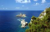 Rock on coast at Corfu island — Stock Photo