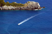 Motorboat and peninsula at Corfu island — Stock Photo