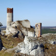 Ruined medieval castle with tower in Olsztyn - Stock Photo