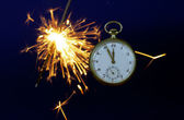 Fob watch and fireworks — Stockfoto