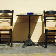 Chairs and table in Greek tavern — Stock Photo #19699675