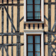 Stock Photo: Windows in tenement house- old city of Troyes