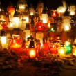 Candles on the grave — Stock Photo #34771135