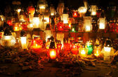 Candles on the grave — Stock Photo