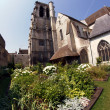 Garden with a medieval church — Stock Photo