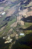 The road, buildings and cultivated fields aerial view — Foto Stock