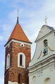 The baroque church with a Gothic tower — Stock Photo