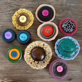 Handmade brooches with buttons — Stock Photo
