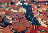 Urban scene across built up area showing roof tops — Stok fotoğraf