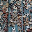Antique rusty  keys on old wooden door — Stock Photo #45920587