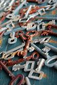 Antique rusty  keys on old wooden door — Stock Photo