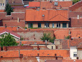 Urban scene across built up area showing roof tops — 图库照片