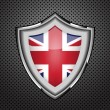Royalty-Free Stock Vector Image: Protection metal shield United Kingdom flag.Vector
