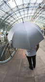 Man with silver umbrella — Stock Photo